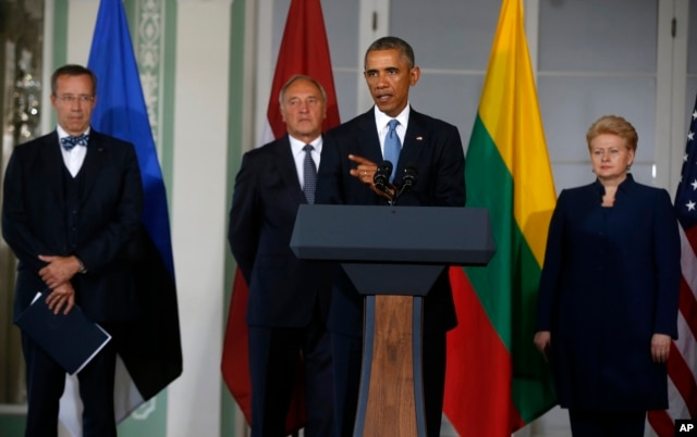 President Barack Obama, center, accompanied by the leaders of Baltic States, from left, Estonia President Toomas Hendrik Ilves, Latvia President Andris Berzins and Lithuanian President Dalia Grybauskaite, speaks after their meeting at Kadriorg Art Museum