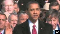 Barack Obama getting sworn into office, 20 Jan 2009