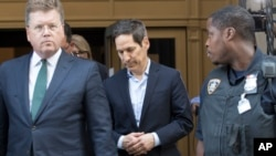 Thomas Frieden, center, leaves Brooklyn federal court, Aug. 24, 2018, in New York. Frieden is the former director of the U.S. Centers for Disease Control and Prevention.
