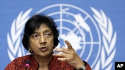 U.N. High Commissioner for Human Rights Navi Pillay gestures during a press conference in Geneva.