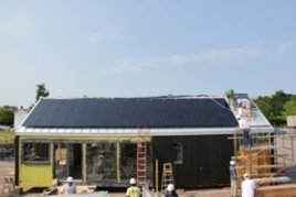 Professional builders worked with students to construct the solar-powered house.