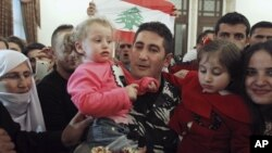 Lebanese policeman who was captured by al Qaeda-linked Nusra Front in Arsal, gets greeted by his family in Beirut, Dec. 1, 2015.