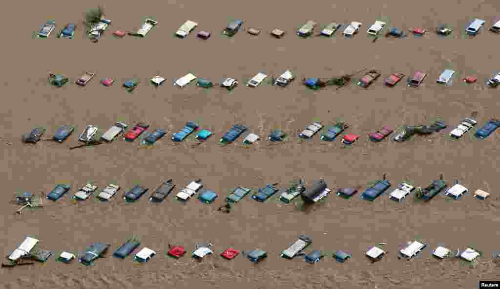 An aerial view of vehicles submerged in flood waters along the South Platte River near Greenley, Colorado, Sept. 14, 2013.
