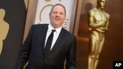 FILE - Harvey Weinstein arrives at the Oscars at the Dolby Theatre in Los Angeles, March 2, 2014.