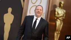 FILE - Harvey Weinstein arrives at the Oscars, March 2, 2014, at the Dolby Theatre in Los Angeles.
