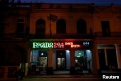 A neon sign shines above the entrance of the restaurant Prado 264, in Havana, Cuba, Feb. 15, 2018.