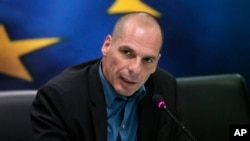 Greek Finance Minister Yanis Varoufakis answers a reporter's question during a joint news conference with Eurogroup President Jeroen Dijsselbloem, following their meeting at the Finance Ministry in Athens, Jan. 30, 2015.
