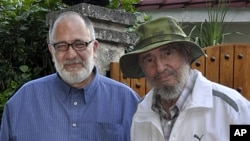 Cuba's former President Fidel Castro, right, poses for a picture with Mario Silva, a journalist from Venezolana de Television, in Havana, Cuba, September 4, 2011.