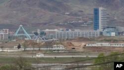 FILE - The Kaesong industrial complex in North Korea is seen from the Taesungdong freedom village inside the demilitarized zone during a press tour in Paju, South Korea, April 24, 201,. The rival Koreas have opened their first liaison office near their tense border to facilitate better communication and exchanges.