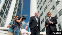 FILE - Palestinian Foreign Minister Riad al-Malki (C) leaves the International Criminal Court (ICC) at the Hague, Aug. 5, 2014.