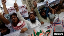 FILE - Supporters of the Jamaat-ud-Dawa organization chant slogans during a protest rally in Karachi, June 27, 2014.
