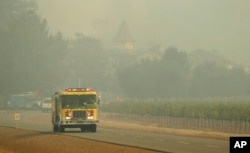 A firetruck makes its way through the Chateau St. Jean winery, Oct. 10, 2017, in Kenwood, Calif.