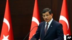 Perdana Menteri Turki Ahmet Davutoglu (AP Photo/Hakan Goktepe, Pool)