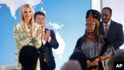 Ivanka Trump, left, the daughter and assistant to President Donald Trump, applauds after listening to a speech made by Francisca Awah Mbuli, right, from Cameroon and survivor of human trafficking, during an event to announce the 2018 Trafficking in Person