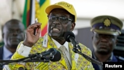 FILE: Zimbabwe's President Robert Mugabe addresses supporters at the elective congress in Harare, Zimbabwe, Dec. 4, 2014.