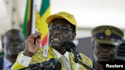 FILE - Zimbabwean President Robert Mugabe is seen addressing supporters in Harare, Zimbabwe, Dec. 4, 2014.