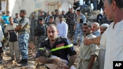 An Iraqi emergency worker carries the lifeless body of 6-month-old Shahad Mohammed from the bombed out ruins of his home in Tikrit, 80 miles (130 kilometers) north of Baghdad, 19 Oct 2010