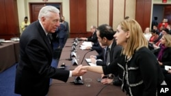House Minority Whip Steny Hoyer of Maryland, left, greets Farah Al Khafaji, a former Iraqi interpreter for the U.S. military, on Capitol Hill in Washington before a House Democratic forum on President Donald Trump's executive order on immigration, Feb. 2, 2017.