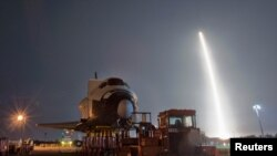 The SpaceX Falcon 9 test rocket lifts off from Space Launch Complex 40 at the Cape Canaveral Air Force Station.