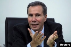 FILE - Argentine prosecutor Alberto Nisman, seens in his office in Buenos Aires, May 29, 2013.