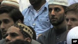 Muslim men attending Al-Hidayah 2010 in Britain, which is being billed as an anti-terrorism summer camp.