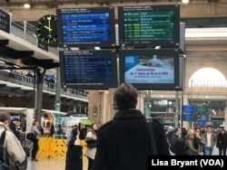 Passengers await trains to northern France and the Netherlands at the Gare du Nord train station in Paris.