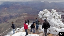 "Visitors at the Grand Canyon's Yavapai Point, which is, not surprisingly, in the ""Grand Canyon State"""