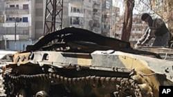 20일 홈즈 시내 시리아 군의 장갑차