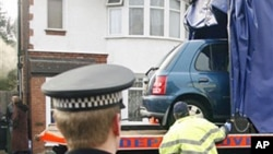 A car belonging to Taimour Abdulwahab, the suspected Stockholm suicide bomber, being removed by police in Luton, England, 13 Dec 2010