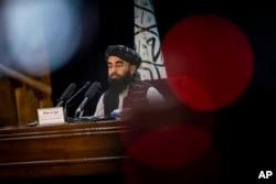 Taliban government spokesman Zabihullah Mujahid gives a press conference in Kabul, Afghanistan, Sept. 21, 2021.