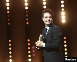 "Director Sebastian Lelio receives the Silver Bear for Best Script for movie ""A Fantastic Woman"" during the awards ceremony at the 67th Berlin International Film Festival in Berlin, Germany, Feb. 18, 2017."