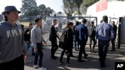 High school students enter the Alexis de Tocqueville school in Grasse, southern France, the day after a 16-year-old student opened fire, wounding three other students and the principal, March 17, 2017.