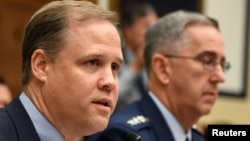FILE - NASA Administrator Jim Bridenstine (L) makes remarks during the House Armed Services Strategic Forces Subcommittee's joint hearing with the House Science, Space and Technology Committee, in Washington, June 22, 2018.