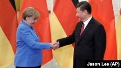 Канцлер Німеччини Анґела Меркель і президент Сі Цзіньпін у Пекіні