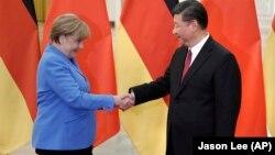 2018年5月24日中国国家主席习近平在北京人民大会堂会见德国总理默克尔。
