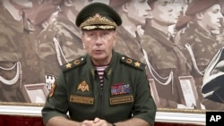 In this video grab taken from Rosguardia official website, National Guard chief Viktor Zolotov speaks as he records an emotional speech, posted on the National Guard's YouTube channel in Moscow, Russia, Tuesday, Sept. 11, 2018. President Vladimir Putin's former bodyguard and chief of the National Guard has challenged opposition leader Alexei Navalny to a duel.