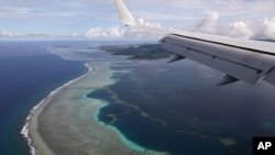 U.S. Secretary of State Mike Pompeo's plane makes its landing approach on Pohnpei International Airport in Kolonia, Federated States of Micronesia August 5, 2019. REUTERS/Jonathan Ernst/File Photo/File Photo