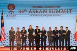FILE - ASEAN leaders shake hands on stage during the opening ceremony of the 34th ASEAN Summit at the Athenee Hotel in Bangkok, Thailand, June 23, 2019.