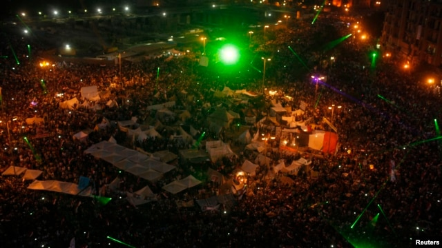 Laser lights are seen as anti-Morsi protesters gather in Cairo's Tahrir Square, July 3, 2013.