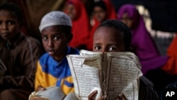 Somali refugee boys recite the Koran at a Madrassa, or Islamic religious school, at Dadaab refugee camp, Dec. 19, 2017.