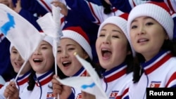 North Koreans attend the women's preliminary round ice hockey match between Sweden and the Unified Korean team druing the Pyeongchang 2018 Winter Olympics in Gangneung, South Korea, Feb. 12, 2018.