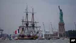 FILE - The tall ship Hermione, a replica of the 18th-century frigate that carried news of French support for the American revolution, passes the Statue of Liberty in New York, July 4, 2015.