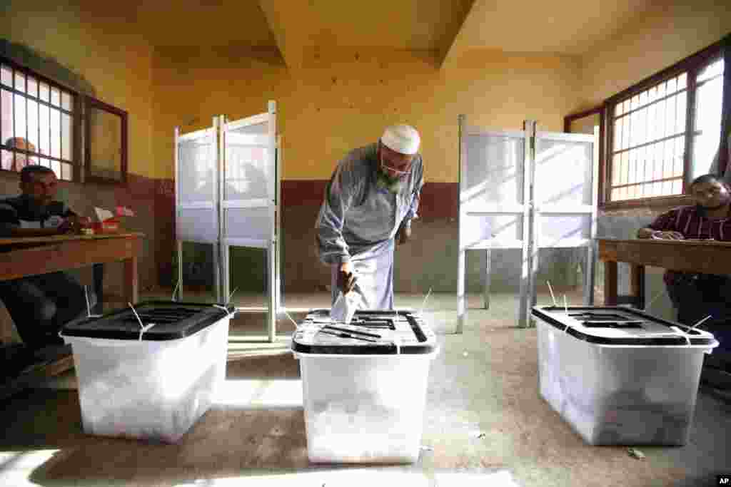 An Egyptian man cast his vote inside a polling station, in Old Cairo, Egypt, Wednesday, May 23, 2012. More than 15 months after autocratic leader Hosni Mubarak's ouster, Egyptians streamed to polling stations Wednesday to freely choose a president for the
