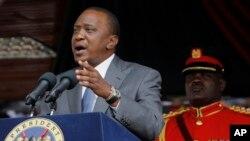 FILE - Kenyan President Uhuru Kenyatta delivers a speech at the Nyayo Nationa Stadium in Nairobi.