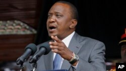 FILE - Kenyan President Uhuru Kenyatta delivers a speech at the Nyayo Nationa Stadium in Nairobi, Kenya.