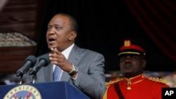 FILE - Kenyan President Uhuru Kenyatta delivers a speech at the Nyayo Nationa Stadium in Nairobi, Kenya.