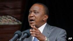 FILE - Kenyan President Uhuru Kenyatta delivers a speech at the Nyayo Nationa Stadium in Nairobi, Kenya. Kenyatta faces crimes against humanity in violence following 2007 election.