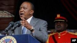 FILE - Kenyan President Uhuru Kenyatta delivers a speech at the Nyayo National Stadium in Nairobi.