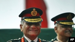 Indian Army Chief Gen. V.K. Singh smiles during a ceremony on the occasion of the Indian Army Day in New Delhi, India, FILE January 15, 2012.