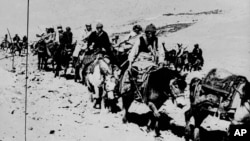In this March 21, 1959 file photo the Dalai Lama and his escape party is shown on the fourth day of their flight to freedom as they cross the Zsagola pass, in Southern Tibet, while being pursued by Chinese military forces, after fleeing Lhasa.